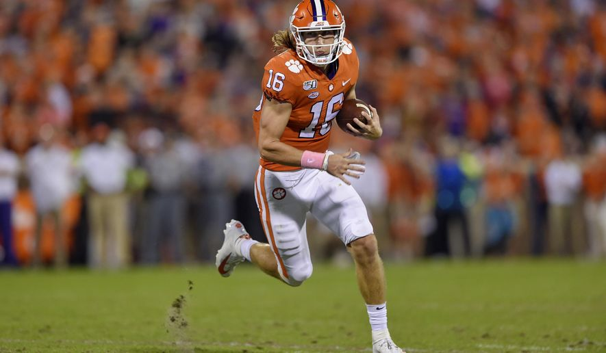 Clemson's Trevor Lawrence rushes on a quarterback keeper during the first half of an NCAA college football game against Boston College, Saturday, Oct. 26, 2019, in Clemson, S.C. (AP Photo/Richard Shiro)