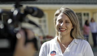 In this Nov. 6, 2018, file photo, Katie Hill, then a Democratic Party candidate from California's 25th Congressional District, talks to a reporter after voting in her hometown of Agua Dulce, Calif., a lightly populated expanse of grassy hills and horse ranchettes north of Los Angeles. (AP Photo/Marcio Jose Sanchez, File)
