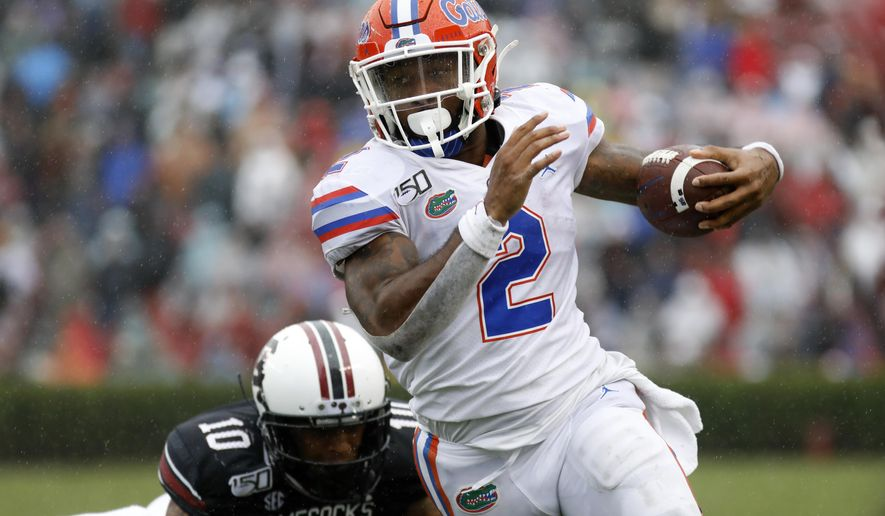 Florida's Lamichal Perine (2) runs away from South ...