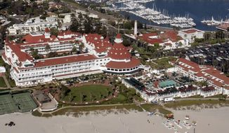 FILE - This Aug. 29, 2005, file photo, shows an aerial view of the historic Hotel del Coronado in Coronado, Calif. Southern California's historic Hotel Del Coronado could temporarily cut up to 160 employees as it prepares to shut down boutiques, a restaurant and its spa amid renovations. The San Diego Union-Tribune reports Thursday, Oct. 31, 2019, the beach resort notified the state it may have to lay off 10% of its workforce. But the hotel tells the Employment Development Department it's possible the cuts could be fewer than anticipated or staggered. (AP Photo/Susan Walsh,File)