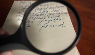 In this Wednesday, Oct. 30, 2019 photo, an official at an auction house shows a handwritten letter by Sigmund Freud, in Jerusalem. The letter which shows a rare sentimental side to the 20th century thinker as well as insight into the life of a prominent Jewish refugee amid the advance of the Nazis, is set to be auctioned on Dec. 3, with a $6,000 opening bid. The letter, written in German and dated June 21, 1938, was sent several weeks after Freud fled the Nazis in his native Austria and moved to London. (AP Photo/Patty Nieberg)