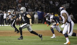 FILE - In this Sept. 9, 2019, file photo, Oakland Raiders quarterback Derek Carr runs with the ball during the first half of the team's NFL football game against the Denver Broncos in Oakland, Calif. The Raiders are playing at home this week for the first time in nearly seven weeks, against the Detroit Lions. (AP Photo/Ben Margot, File)
