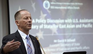 """David Stilwell, the U.S. State Department's assistant secretary for East Asia and the Pacific, left, speaks during a forum in Kuala Lumpur, Thursday, Oct. 31, 2019.  The senior U.S. official says a free and open Indo-Pacific concept is not a move to expand U.S. domination but reflects Washington's """"enduring engagement"""" to prosper the region. (AP Photo/Vincent Thian)"""
