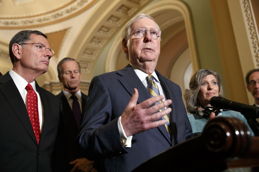 Senate Majority Leader Mitch McConnell of Ky., speaks to the media with members of the Senate Republican leadership, from left, Sen. John Barrasso, R-Wyo., Sen. John Thune, R-S.D., McConnell, and Sen. Joni Ernst, R-Iowa, Tuesday, Oct. 29, 2019, after their weekly policy luncheon on Capitol Hill in Washington. (AP Photo/Jacquelyn Martin)