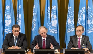 From left, Constitutional Committee Co-Chairman Ahmad Kuzbari, representative of the Syrian Government, Geir O. Pedersen, Special Envoy for Syria and the Constitutional Committee Co-Chairman, Hadi al-Bahra, representative of the Syrian opposition, speak during the first meeting of the Syrian Constitutional Committee at the European headquarters of the United Nations in Geneva, Switzerland, Wednesday, October 30, 2019. (Martial Trezzini/Keystone via AP)