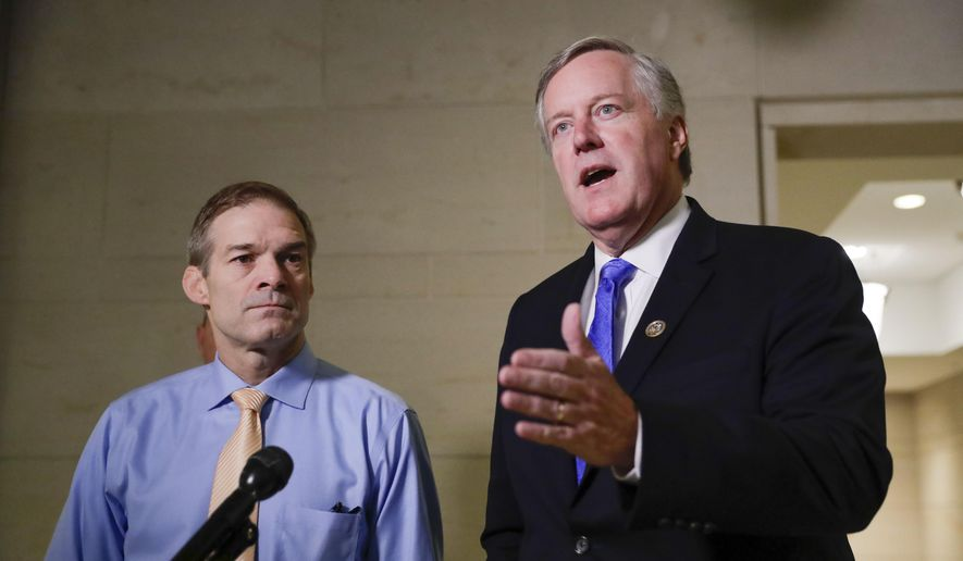 Rep. Mark Meadows, R-N.C., right, speaks to members of the media as Rep. Jim Jordan, R-Ohio, left, looks on as they arrive for closed-door meeting to hear testimony from Tim Morrison, a former senior National Security Council official, in the House impeachment inquiry about President Donald Trump's efforts to press Ukraine to investigate his political rivals, at the Capitol in Washington, Thursday, Oct. 31, 2019. (AP Photo/Pablo Martinez Monsivais) ** FILE **