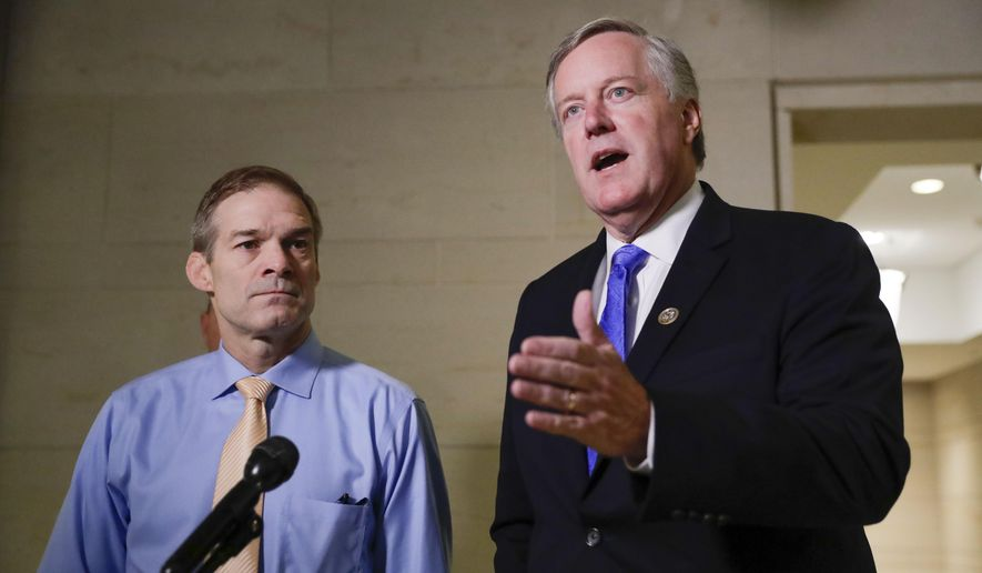In this file photo, Rep. Mark Meadows, R-N.C., right, speaks to members of the media as Rep. Jim Jordan, R-Ohio, left, looks on as they arrive for closed-door meeting to hear testimony from Tim Morrison, a former senior National Security Council official, in the House impeachment inquiry about President Donald Trump's efforts to press Ukraine to investigate his political rivals, at the Capitol in Washington, Thursday, Oct. 31, 2019. (AP Photo/Pablo Martinez Monsivais) ** FILE **