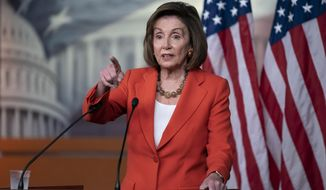 Speaker of the House Nancy Pelosi, D-Calif., talks to reporters just before the House vote on a resolution to formalize the impeachment investigation of President Donald Trump, in Washington, Thursday, Oct. 31, 2019. (AP Photo/J. Scott Applewhite)