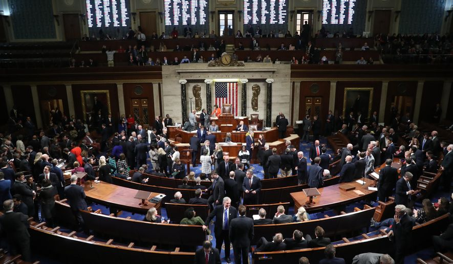House members vote on the House resolution to move forward with procedures for the next phase of the impeachment inquiry into President Trump in the House Chamber on Capitol Hill in Washington, Thursday, Oct. 31, 2019. (AP Photo/Andrew Harnik)