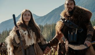 """This image released by Apple TV Plus shows Jason Momoa, right, and Hera Hilmar in a scene from """"See,"""" premiering Friday, Nov. 1, 2019, on Apple TV Plus. (Apple TV Plus via AP)"""