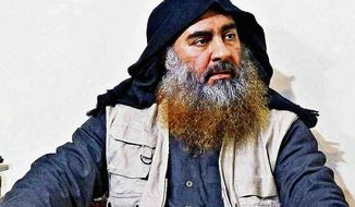 This image released by the Department of Defense on Wednesday, Oct. 30, 2019, and displayed at a Pentagon briefing, shows an image of Islamic State leader Abu Bakr al-Baghdadi. (Department of Defense via AP)