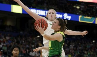 FILE - In this April 5, 2019, file photo, Oregon guard Sabrina Ionescu (20) drives to the basket as Baylor forward Lauren Cox (15), defends during a Final Four semifinal of the NCAA women's college basketball tournament in Tampa, Fla. Ionescu was named to The Associated Press Preseason All-America women's college basketball team, Thursday, Oct. 31, 2019. (AP Photo/Chris O'Meara, File)