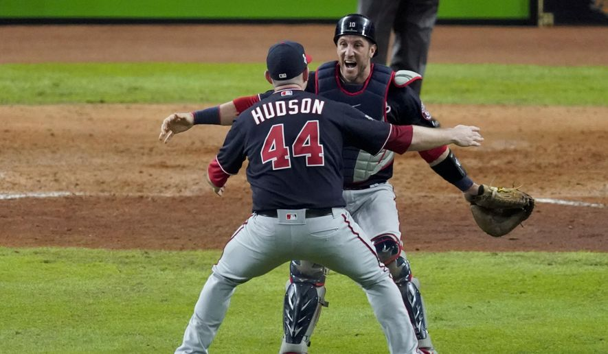 Washington Nationals relief pitcher Daniel Hudson and catcher Yan Gomes celebrate after Game 7 of the baseball World Series against the Houston Astros Wednesday, Oct. 30, 2019, in Houston. The Nationals won 6-2 to win the series. (AP Photo/Eric Gay)