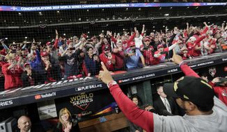 Washington Nationals manager Dave Martinez waves to the fans after Game 7 of the baseball World Series against the Houston Astros Wednesday, Oct. 30, 2019, in Houston. The Nationals won 6-2 to win the series. (AP Photo/David J. Phillip)