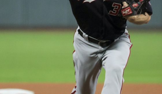 Washington Nationals starting pitcher Max Scherzer throws against the Houston Astros during the first inning of Game 7 of the baseball World Series Wednesday, Oct. 30, 2019, in Houston. (AP Photo/Mike Ehrmann, Pool)