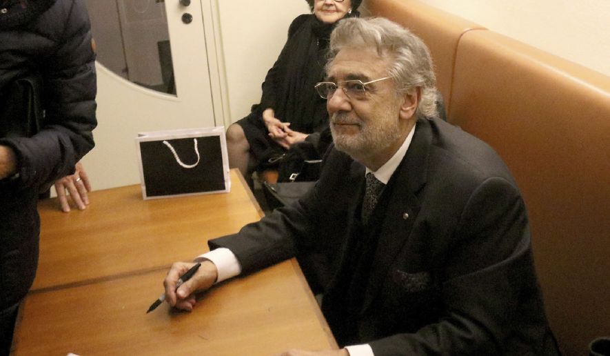 """Opera tenor Placido Domingo waits to give autographs after he performed """"Macbeth"""" from Giuseppe Verdi at Austrian State Opera in Vienna, Austria, Friday, Nov. 1, 2019. (AP Photo/Ronald Zak)"""