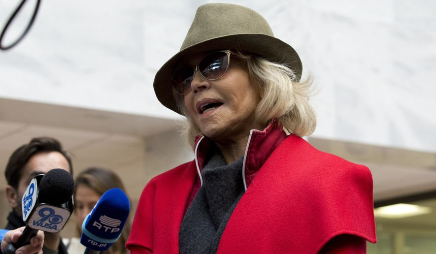 Actress and activist Jane Fonda talk to reporters at Hart Senate Office Building as she and other demonstrators called on Congress for action to address climate change, on Capitol Hill in Washington, Friday, Nov. 1, 2019. A half-century after throwing her attention-getting celebrity status into Vietnam War protests, Fonda is now doing the same in a U.S. climate movement where the average age is 18. (AP Photo/Jose Luis Magana)