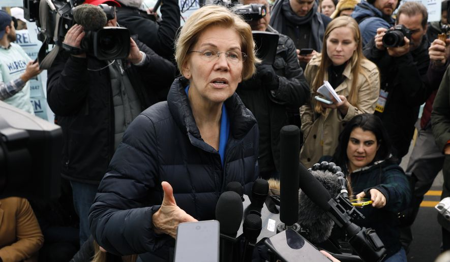 Democratic presidential candidate Sen. Elizabeth Warren speaks to reporters before the Iowa Democratic Party's Liberty and Justice Celebration, Friday, Nov. 1, 2019, in Des Moines, Iowa. (AP Photo/Charlie Neibergall)