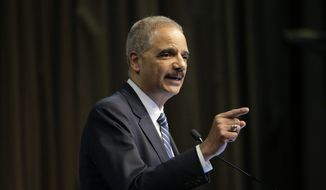 In this April 3, 2019, file photo, former U.S. Attorney General Eric Holder Jr. speaks during the National Action Network Convention in New York. (AP Photo/Seth Wenig, File)