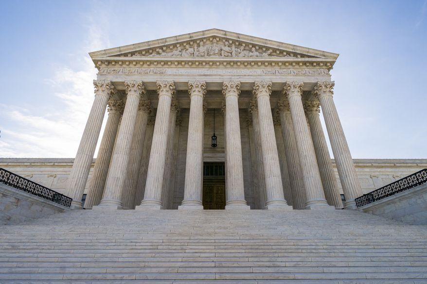 In this June 17, 2019 photo, The U.S. Supreme Court is shown in Washington. (AP Photo/J. Scott Applewhite)