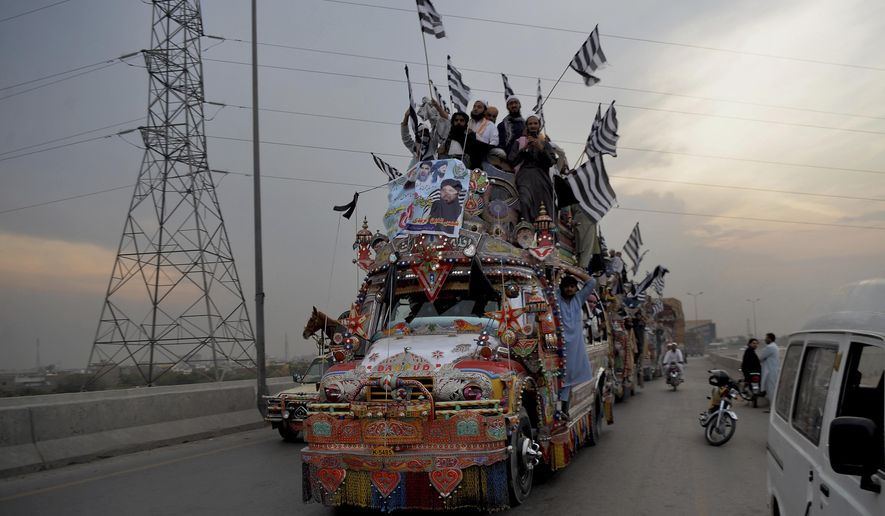 Supporters of the Pakistani firebrand cleric Maulana Fazlur Rehman, head of the Jamiat Ulema-e-Islam party, leave for Islamabad to participate in an anti government march, in Peshawar, Pakistan, Thursday, Oct. 31, 2019. Thousands of supporters of the ultra-religious political party led by Rehman took part in the anti-government procession headed to Pakistan's capital. (AP Photo/Muhammad Sajjad)