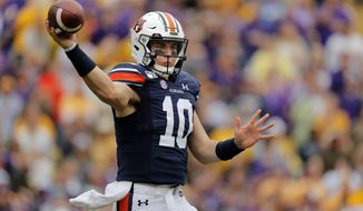 Auburn quarterback Bo Nix (10) passes in the first half of an NCAA college football game against LSU in Baton Rouge, La., Saturday, Oct. 26, 2019. (AP Photo/Gerald Herbert)