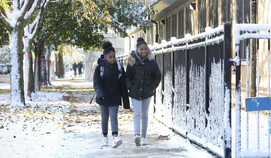 Students return to school at Yates Elementary Friday, Nov. 1, 2019, in Chicago after a Chicago Teachers Union strike closed schools for 11 days. (AP Photo/Teresa Crawford)