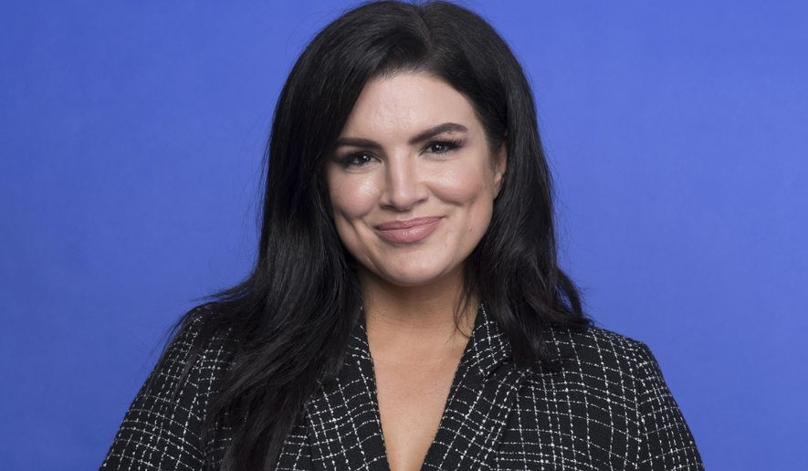 """This Oct. 19, 2019, file photo shows Gina Carano at the Disney Plus launch event promoting """"The Mandalorian"""" at the London West Hollywood hotel in West Hollywood, Calif. (Photo by Mark Von Holden/Invision/AP)"""