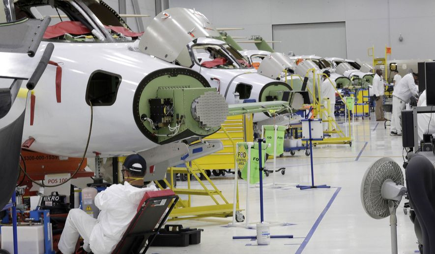 FILE - In this July 30, 2019, file photo people work in the production area at the Honda Aircraft Co. headquarters in Greensboro, N.C. where the HondaJet Elite aircraft is manufactured. On Friday, Nov. 1, the Institute for Supply Management, an association of purchasing managers, reports on activity by U.S. manufacturers in October. (AP Photo/Gerry Broome, File)