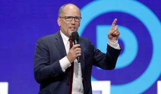 FILE - In this Tuesday, Oct. 15, 2019, file photo, Tom Perez speaks before a Democratic presidential primary debate hosted by CNN/New York Times at Otterbein University, in Westerville, Ohio. The Democratic National Committee is increasing pressure on its presidential candidates to commit to campaign actively for the party's nominee in 2020. The unity push from Chairman Perez is part of a wide-ranging voter outreach strategy designed to prevent the mistakes that cost Democrats the 2016 presidential election. (AP Photo/John Minchillo, File)