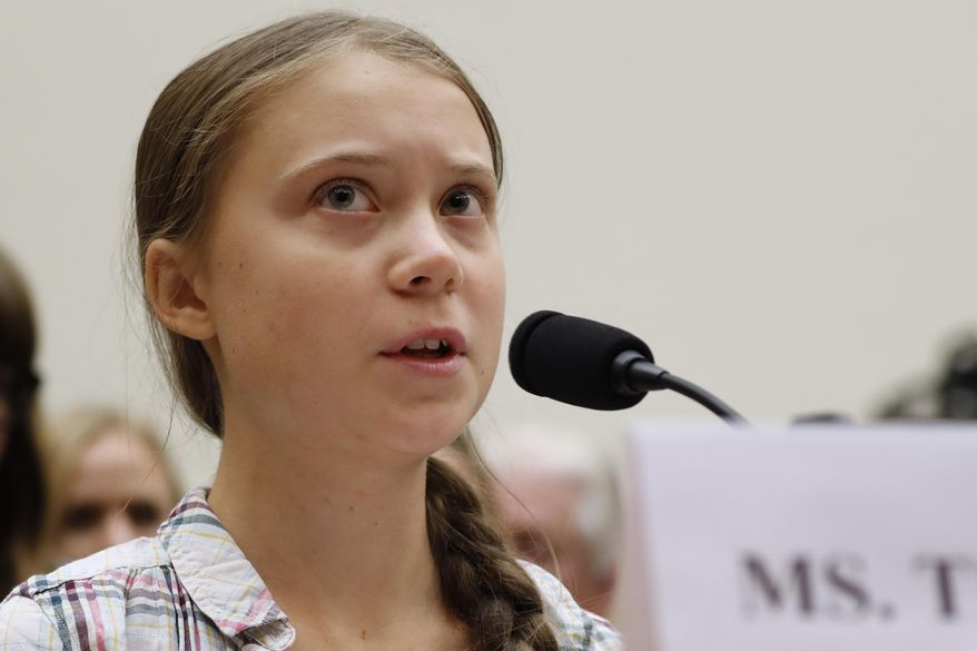 In this Wednesday, Sept. 18, 2019, file photo, youth climate change activist Greta Thunberg speaks at a House Foreign Affairs Committee subcommittee hearing on climate change, on Capitol Hill in Washington. Thunberg, 16, of Sweden, who accused international leaders of ignoring the dangers of global warming in a speech shared around the world is joining young fellow activists in Los Angeles on Friday, Nov. 1, for a protest aimed at getting California out of the oil-drilling business. (AP Photo/Jacquelyn Martin, File)