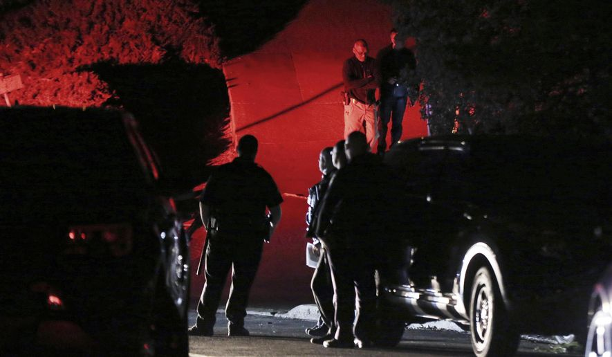 Contra Costa County Sheriff deputies investigate a multiple shooting in Orinda, Calif., on Thursday, Oct. 31, 2019. Four people were killed and four others wounded in a Halloween night party shooting at a large rental home in a wealthy San Francisco Bay Area community, police said Friday.  The shooting in the city of about 20,000 just east of Berkeley, happened at a party attended by 100 people said police chief David Cook. (Ray Chavez/East Bay Times via AP)