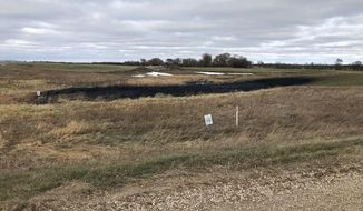 This Wednesday, Oct. 30, 2019 photo provided by the North Dakota Department of Environmental Quality shows affected land from a Keystone oil pipeline leak near Edinburg, North Dakota. Regulators said TC Energy's Keystone pipeline leaked an estimated 383,000 gallons of oil in northeastern North Dakota, though the cause was still under investigation. (North Dakota Department of Environmental Quality/Taylor DeVries)