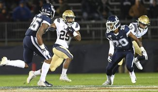 Navy wide receiver Tazh Maloy (25) gains yardage during the first half of the team's NCAA college football game against Connecticut on Friday, Nov. 1, 2019, in East Hartford, Conn. (AP Photo/Stephen Dunn)