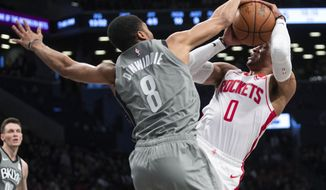 Brooklyn Nets guard Spencer Dinwiddie (8) guards Houston Rockets guard Russell Westbrook (0) during the first half of an NBA basketball game Friday, Nov. 1, 2019, in New York. (AP Photo/Mary Altaffer)