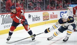 Washington Capitals defenseman Nick Jensen (3) passes the puck as Buffalo Sabres left wing Conor Sheary (43) defends during the second period of an NHL hockey game Friday, Nov. 1, 2019, in Washington. (AP Photo/Nick Wass) ** FILE **