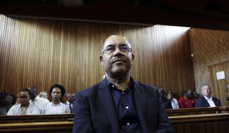 FILE - In this Tuesday Jan. 8, 2019, file photo former Mozambican finance minister, Manuel Chang, appears in court in Kempton Park, Johannesburg, South Africa. A South Africa court has Friday, Nov. 1, 2019, set aside an earlier decision to extradite Chang back to Mozambique, and he may now face extradition to the United Sates. (AP Photo/Phill Magakoe, File)
