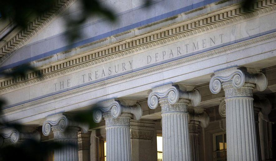 This June 6, 2019, file photo shows the U.S. Treasury Department building at dusk in Washington.  (AP Photo/Patrick Semansky, File) **FILE**