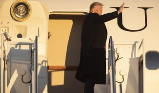 President Donald Trump boards Air Force One on Friday, Nov. 1, 2019, at Andrews Air Force Base, Md. for a trip to a campaign rally in Tupelo, Miss. (AP Photo/Kevin Wolf)
