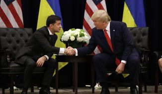 FILE - In this Wednesday, Sept. 25, 2019 file photo, President Donald Trump meets with Ukrainian President Volodymyr Zelenskiy at the InterContinental Barclay New York hotel during the United Nations General Assembly in New York. The House impeachment inquiry is zeroing in on two White House lawyers privy to a discussion about moving a memo recounting President Donald Trump's phone call with the leader of Ukraine into a highly restricted computer system normally reserved for documents about covert action.  (AP Photo/Evan Vucci, File)