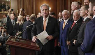House Minority Leader Kevin McCarthy of Calif., center, is joined by fellow Republican lawmakers as he walks up to the podium to begin speaking during a news conference on Capitol Hill in Washington, Thursday, Oct. 31, 2019. Democrats pushed a package of ground rules for their inquiry of President Donald Trump through a sharply divided House, the chamber's first formal vote in a fight that could stretch into 2020 election. (AP Photo/Pablo Martinez Monsivais)