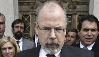 In this April 25, 2006, file photo, John Durham speaks to reporters on the steps of U.S. District Court in New Haven, Conn. Durham, Connecticut's U.S. attorney, is leading the investigation into the origins of the Russia probe. (AP Photo/Bob Child, File)