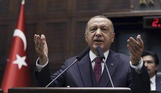 Turkish President Recep Tayyip Erdogan addresses his ruling party legislators at the Parliament, in Ankara, Wednesday, Oct. 30, 2019. (AP Photo/Burhan Ozbilici) ** FILE **