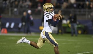 Navy quarterback Malcolm Perry (10) scores during the first half of an NCAA college football game against Connecticut Friday, Nov. 1, 2019, in East Hartford, Conn. (AP Photo/Stephen Dunn) **FILE**