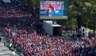 Fans wait for the MLB Washington Nationals to celebrate the team's World Series baseball championship over the Houston Astros, in Washington, Saturday, Nov. 2, 2019. The Washington Nationals are getting a hero's welcome home from a city that had been thirsting for a World Series championship for nearly a century.(AP Photo/Cliff Owen)