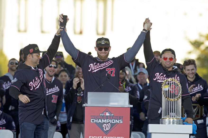 Washington Nationals pitcher and World Series MVP Stephen Strasburg, celebrates the World Series baseball championship during a rally following a parade to celebrate the team's World Series baseball championship over Houston Astros, Saturday, Nov. 2, 2019, in Washington. Nationals right fielder Gerardo Parra is right and pitcher Anibal Sanchez, left.  (AP Photo/Jose Luis Magana)  **FILE**