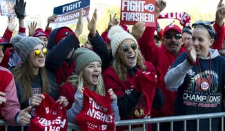 Washington Nationals fans cheers during a rally following the parade to celebrate the team's World Series baseball championship over Houston Astros, Saturday, Nov. 2, 2019, in Washington. (AP Photo/Jose Luis Magana)  **FILE**