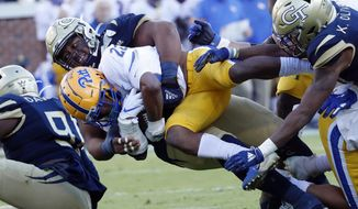 Pittsburgh running back Vincent Davis (22) is tackled by Georgia Tech defensive lineman Djimon Brooks (86) during the first half of an NCAA college football game, Saturday, Nov. 2, 2019, in Atlanta. (AP Photo/John Bazemore)