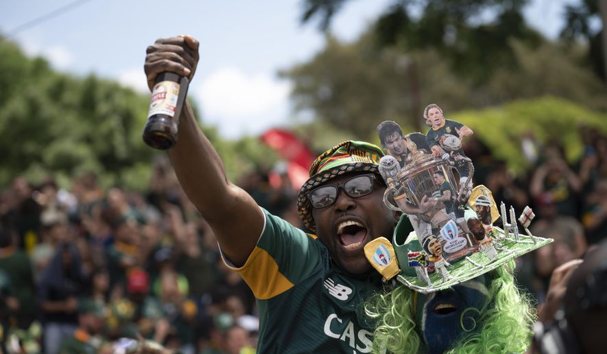 South Africa fans celebrate at the Pirates Rugby Club in Johannesburg, South Africa, after their team's victory in the Rugby World Cup final between South Africa and England being played in Tokyo, Japan on Saturday Nov. 2, 2019. South Africa defeated England 32-12. (AP Photo/Jerome Delay)