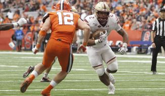 Boston College's AJ Dillon, right, runs past Syracuse's Andrew Armstrong, left, and scores in the fourth quarter of an NCAA college football game in Syracuse, N.Y., Saturday, Nov. 2, 2019. Boston College won 58-27. (AP Photo/Nick Lisi)